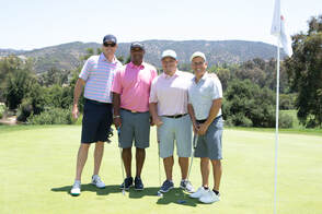 Foursome of golfers on the course at a charity golf tournament in Tarzana by Donna Coleman Photography