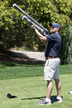 Picture photo of a Golfer using an air cannon at a  Charity  Golf Tournament by Donna Coleman Photography