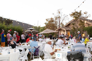 Picture of the dinner at the Mutiny Golf Scramble Charity Golf Tournament at Twin Oaks Golf Club in San Diego by Donna Coleman Photography