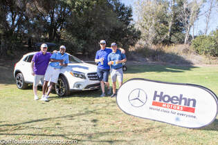 Photo of Sponsor Signage and golfers at a charity golf tournament at Twin Oaks Golf Course in San Marcos by Donna Coleman Photography