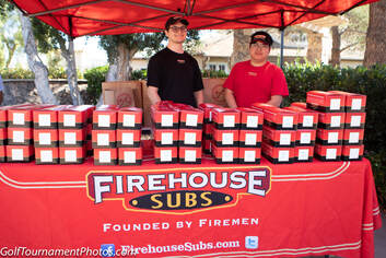 Photo of sponsor FireHouse Subs at the Mutiny Golf Scramble by Donna Coleman Photography at Twin Oaks Golf Course