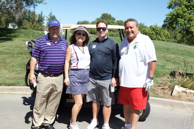 Golfers on the course by golf tournament photos and Donna Coleman Photography in Tarzana for the Play for Parkinson's
