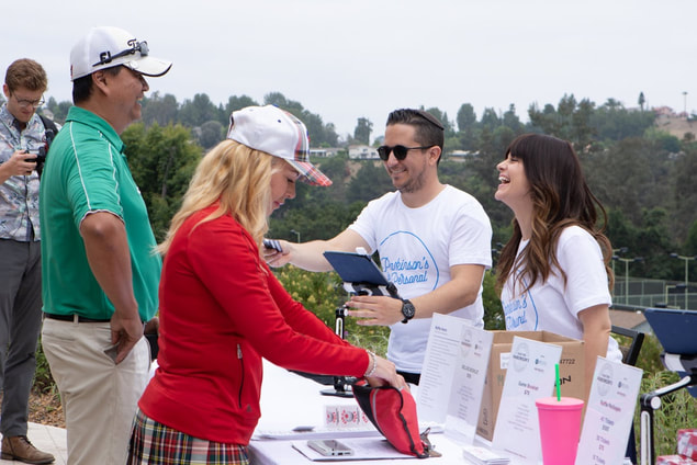 Registration at a golf tournament by Donna Coleman Photography in Tarzana